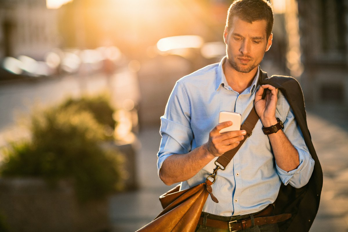 Photo-of-a-young-businessman-using-smart-phone-475967244_3869x2579.jpeg